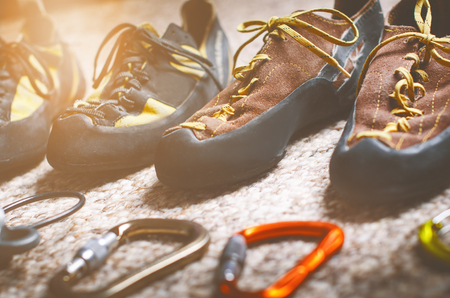 Climbing and mountaineering equipment on a carpet. Shoes, carbine, rope, lope, ascend-er. Concept of outdoor and extreme sport.
