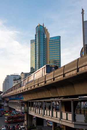Bangkok, Thailand - October 4, 2014: BTS train rushes out of Asok station in Bangkok along Sukhumvit road. This elevated train system has helped considerably to reduce traffic congestion in the city, October 4, 2014 in Bangkok.