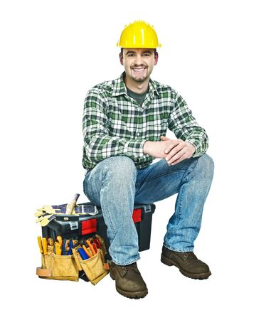 young handyman sit on his toolbox isolated on white