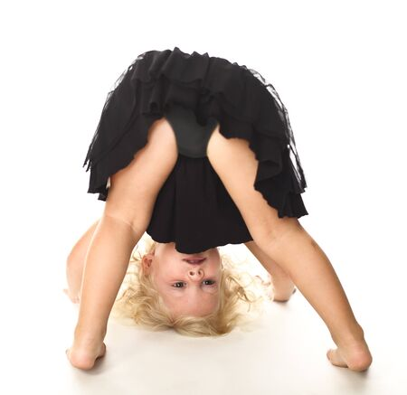 portrait of young blonde child play on floor