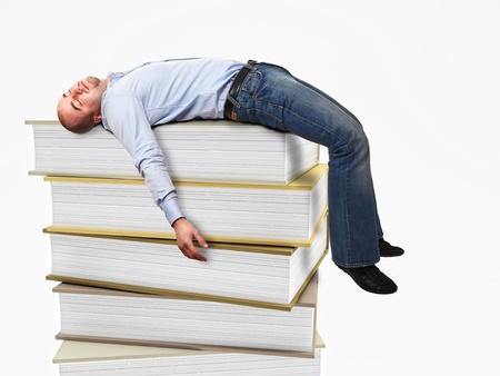 portrait of stressed man sleeping on a 3d book pile