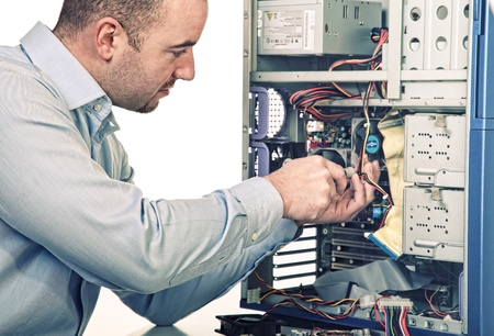 man try to repair his pc on white background