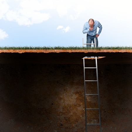 Photo pour man look into ground hole - image libre de droit