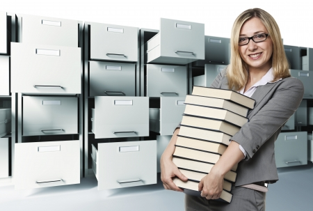 smiling woman with books and file cabinet background
