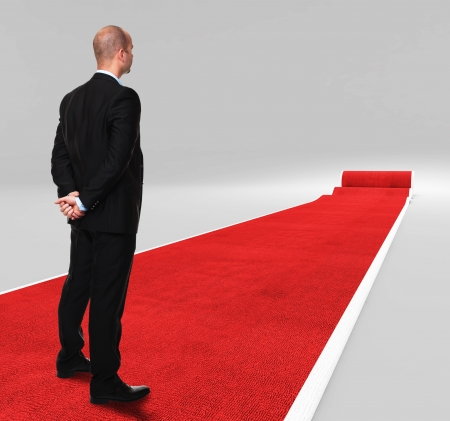 3d image of classic red carpet with standing man