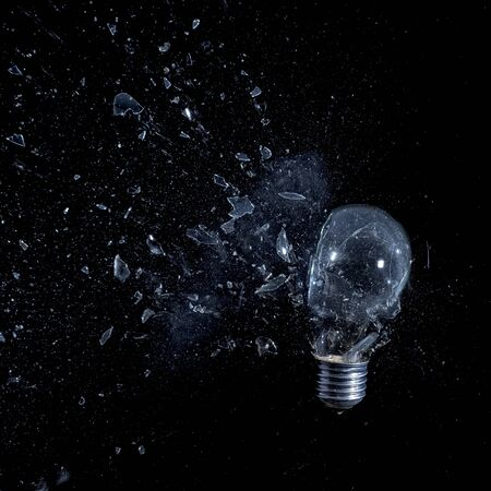 glass bulb explosion on black background