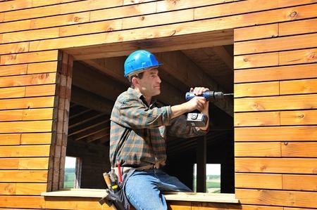 Photo pour a carpenter working in his house - image libre de droit