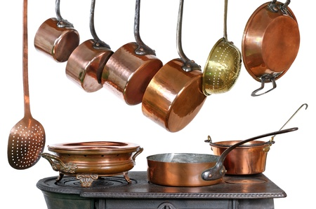 pans and kitchen utensils in copper