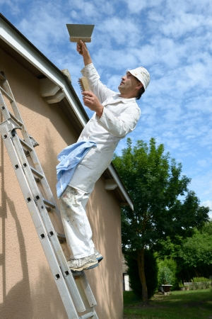 a working house painter who tumbles the ladder