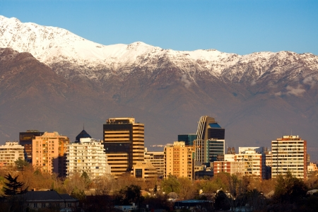 Skyline of Providencia district in Santiago de Chile with snowed Andes mountain range in the background.  This is a wealthy residential and commercial district in the city.