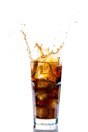 Photo pour Ice splashing on a glass of a Cola drink against a white background - image libre de droit