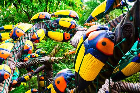 CHONBURI, THAILAND - March 18, 2016: Beautiful garden decoration in Nong Nooch Tropical Botanical Garden. A lot of beetles. Nong Nooch Tropical Botanical Garden is a 500-acre botanical garden in Chonburi, Thailand. Selective focus