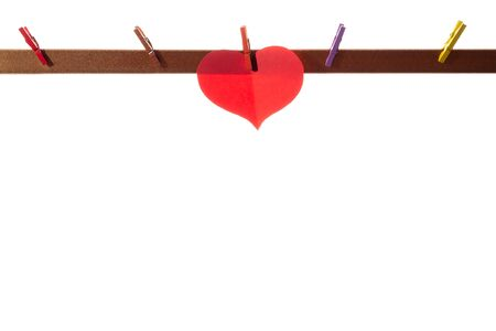 Photo pour Red paper hearts on clothespins on a white background. Valentine's day concept. - image libre de droit