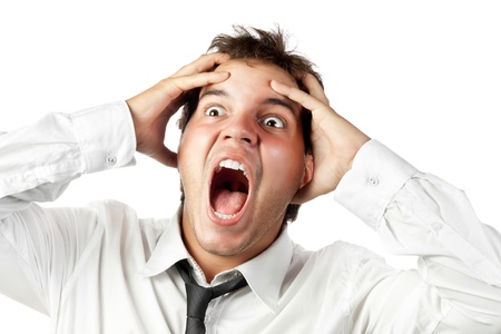 Foto de young office worker mad by stress screaming isolated on white - Imagen libre de derechos