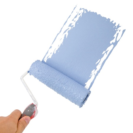 Photo for Painter holding a roller, painting in blue - Royalty Free Image