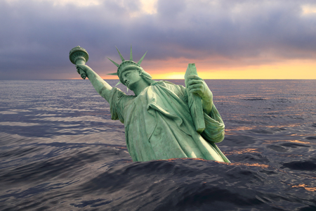 Statue of Liberty sinks in the ocean in the sunset