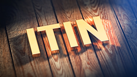 The acronym ITIN is lined with gold letters on wooden planks. 3D illustration image