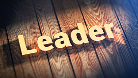 The word Leader is lined with gold letters on wooden planks. 3D illustration image