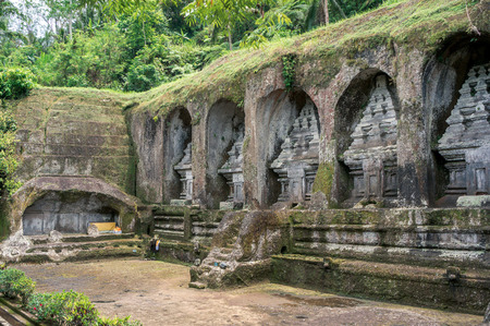 Ancient tombs carved in rock in funeral complex Gunung Kawi near Ubud, Bali, Indonesia