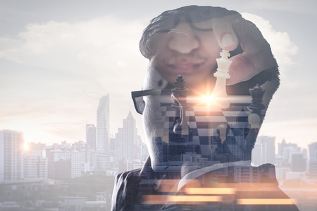 Photo for The double exposure image of the businessman thinking overlay with chess game and cityscape image. the concept of strategic, planning, management, intelligence and education. - Royalty Free Image