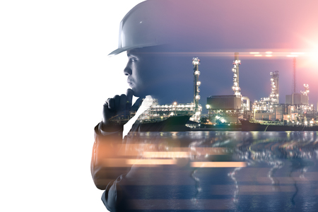 Photo for the double exposure image of the engineer thinking overlay with oil refinery image.The concept of energy, engineering, construction and industrial. - Royalty Free Image