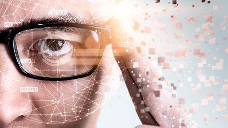 Foto de The abstract image of the businessman wear a smart glasses overlay with futuristic hologram. The concept of modern life, technology, iris scanner and internet of things - Imagen libre de derechos