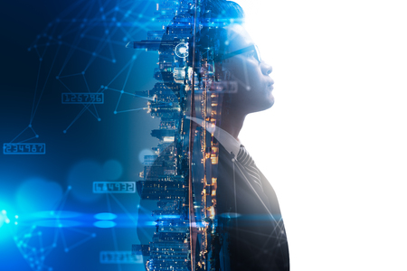 Foto de The double exposure image of the businessman thinking overlay with cityscape image and futuristic hologram. The concept of modern life, business, city life and internet of things - Imagen libre de derechos