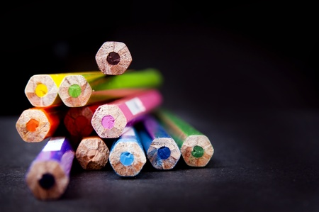 Ends of used pencils in a stack in shallow focus