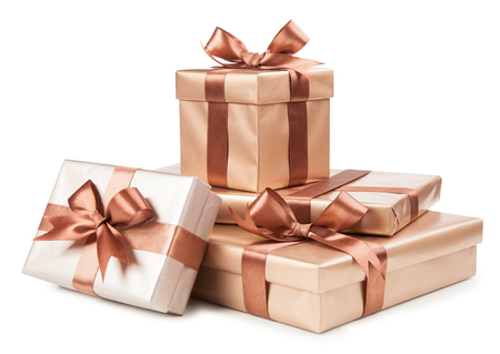 Photo pour Gold boxes with gifts and brown bow isolated on white. - image libre de droit