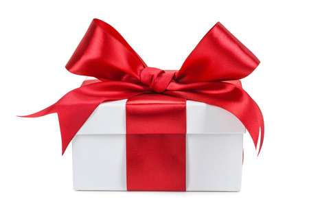 White gift box with red ribbon and bow isolated.