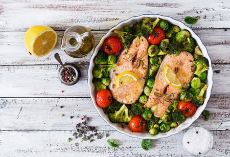 Photo for Baked salmon steak with vegetables. Diet menu. Top view - Royalty Free Image