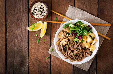 Photo pour Miso and soba noodle soup with roasted tofu and mushrooms. Top view - image libre de droit
