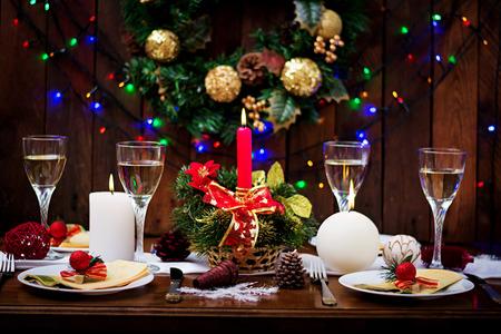 Photo pour Traditional dishware on Christmas table. - image libre de droit