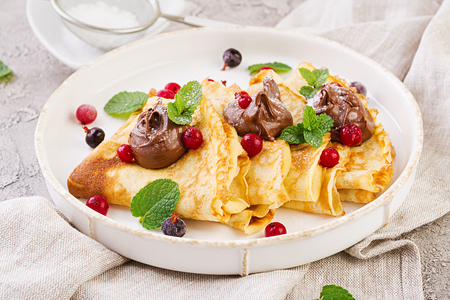 Photo for Pancakes with berries and chocolate decorated with mint leaf. Tasty breakfast. - Royalty Free Image
