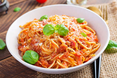 Spaghetti alla Amatriciana with guanciale, tomatoes and pecorino cheese. Italian healthy food.