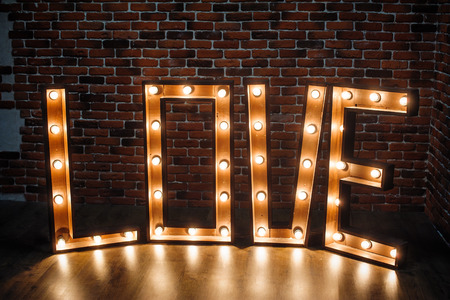 large illuminated letters LOVE in the studio.