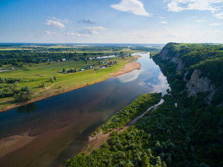 Aerial Russian countryside in a picturesque landscape among mountains and rivers