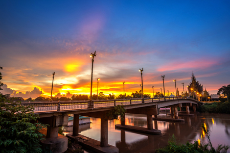 Beautiful of sunset at the Bridge over the Nan River in Phitsanulok City, Thailand.