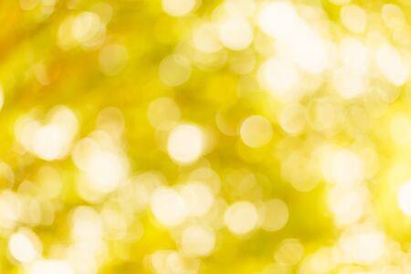 Foto de golden yellow bokeh background with circles. Summer abstract theme. - Imagen libre de derechos