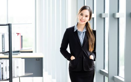 Foto de Portrait of a cheerful mature Asian businesswoman at In the office room background,business expressed confidence embolden and successful concept - Imagen libre de derechos