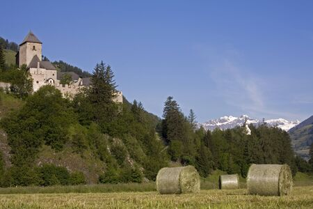 Hay bales in front of the castle of Reifenstein near Sterzing