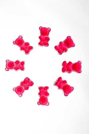 Togetherness - red gummy bear symbolically arranged in a circle