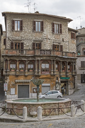 Fountains and old town house in the Centro Storico of Narnini