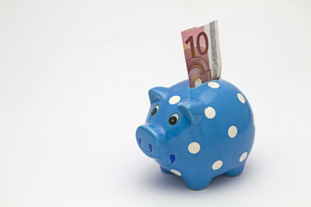 Blue piggy bank with ten euro bill
