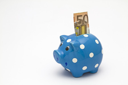 Blue piggy bank with fifty euro bill