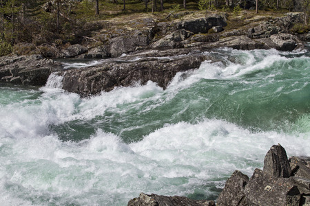 In its course through the Ottadalen the river Otta forms countless massive waterfalls