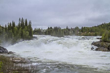 Laksfossen - powerful waterfall south of Mosjen