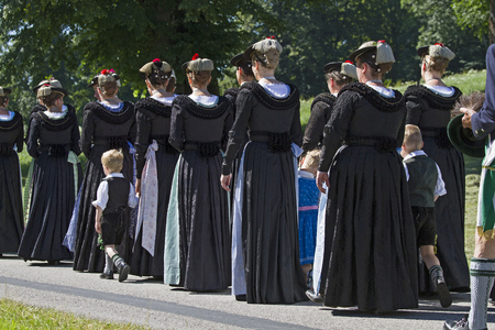 Women go in traditional costume at a procession in Upper Bavaria part
