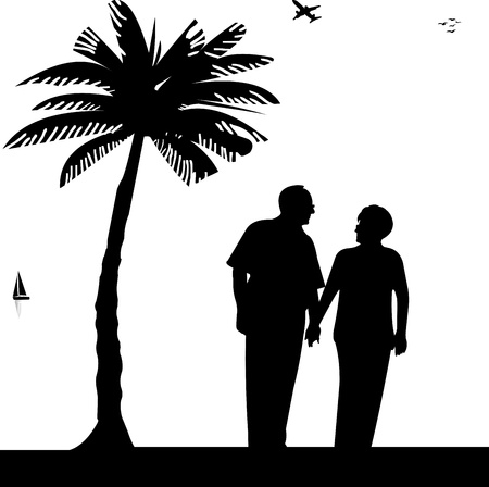 Lovely retired elderly couple walking on the beach, one in the series of similar images silhouette