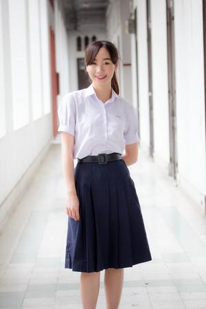 Foto de Portrait of thai high school student uniform teen beautiful girl happy and relax - Imagen libre de derechos